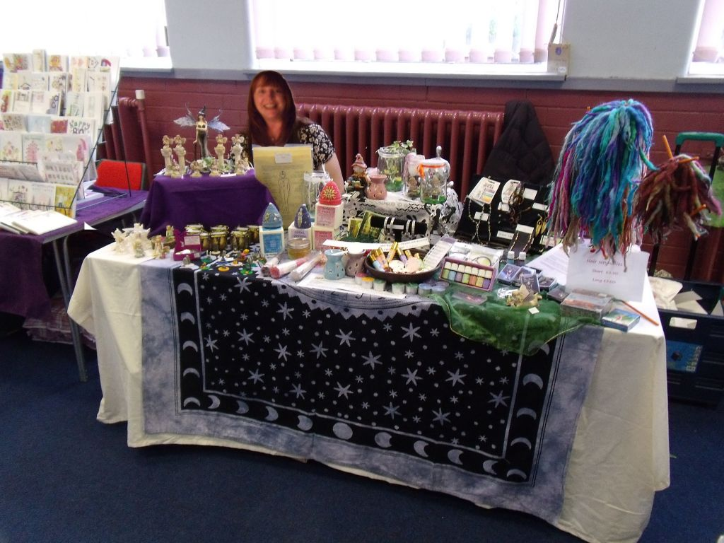 craft fair table with items on