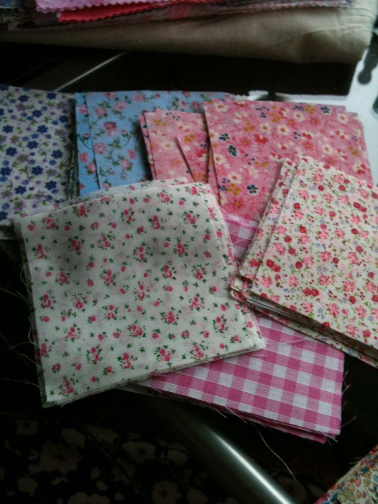 squares of cotton fabric with red or pink flowers