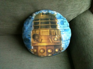 round blue cushion with dalek on