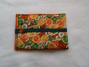 orange fabric kindle cover with green triim and orange button