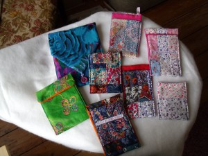 patchwork mobile fone covers in mixed colours - mainky pink and red.  1 green one and 1 purple one in Kaffe Fassett fabric