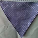 purple fabric with whiite spots made into bunting flag