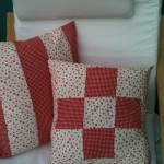 cushions in red and white patchwork