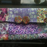 clutch bag in assorted lilac floral Liberty Tana Lawn fabric