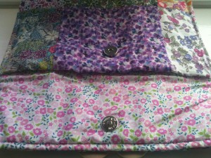 inside of clutch bag showing pretty pink floral fabric lining