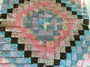 coloured squares in round pattern making a quilt top