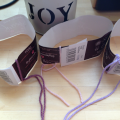 wool labels with yarn tied on