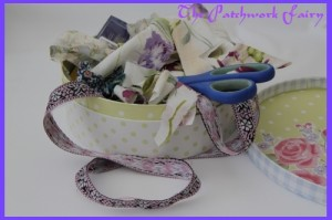 sewing basket with overflowing fabric and ribbon