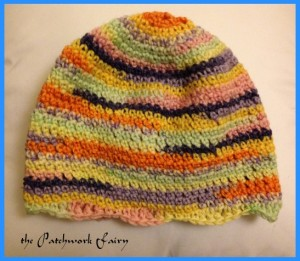 beanie in varigated pink, yellow and orange wool