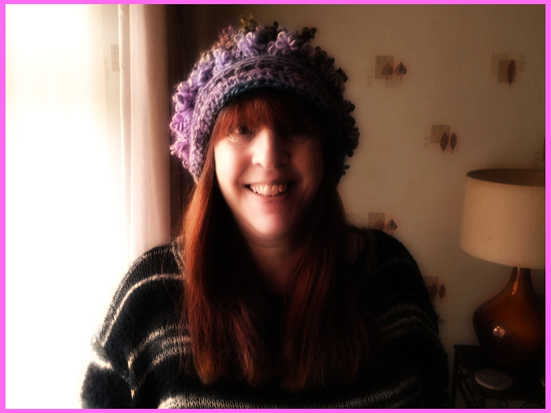 purple and pinky flower wool hat