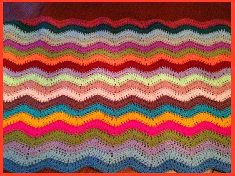 ripple blanket in multi coloured acrylic yarn