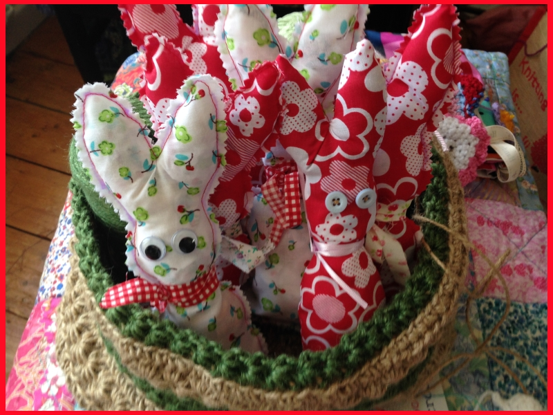 basket of fabric bunnies in red and white and green and white.