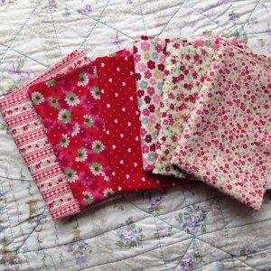 red and pinky-red floral fabric in fat quarters