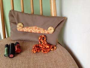 brown and range clutch bag