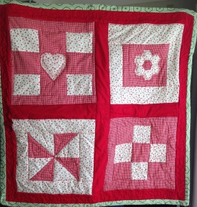 red cotton patchwork quilt