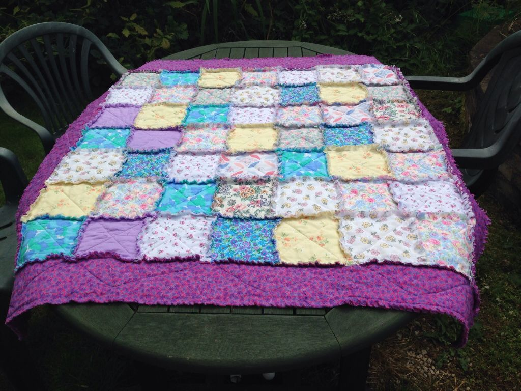 pastel shades of floral fabric rag quilt