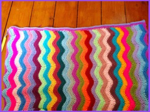 multi-coloured crochet ripple blanket