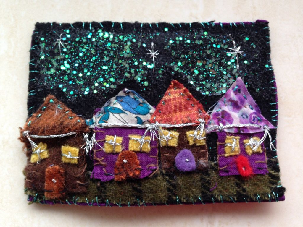 Felted scene of houses with decorations