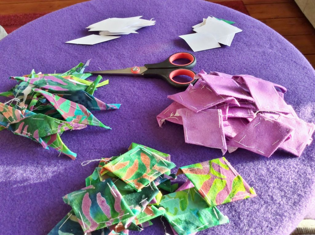 cutting out paper diamonds and covering them with fabric
