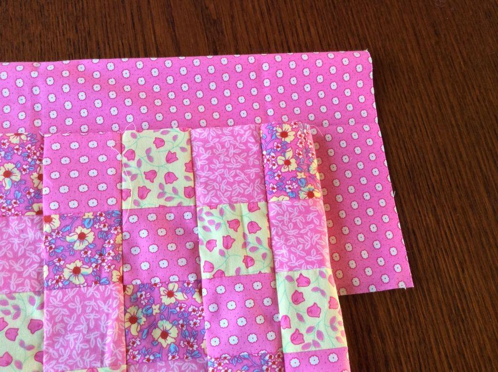Pink and cream baby pram quilt