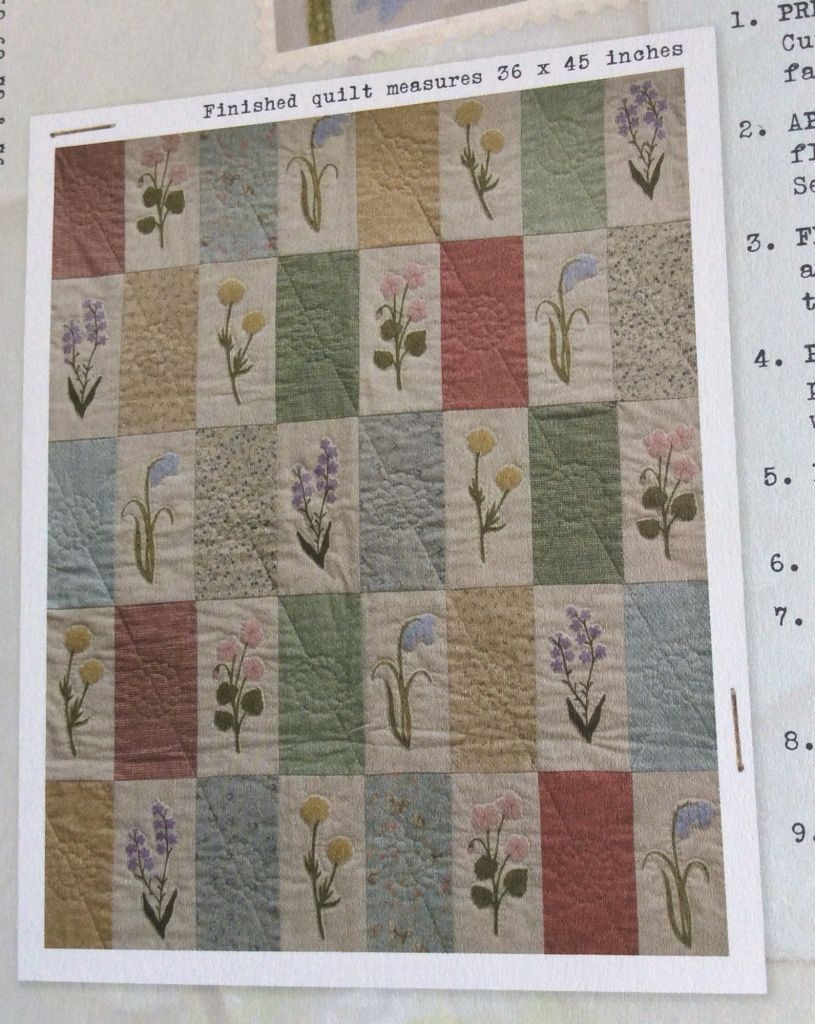 Pastel quilt with flowers appliqued