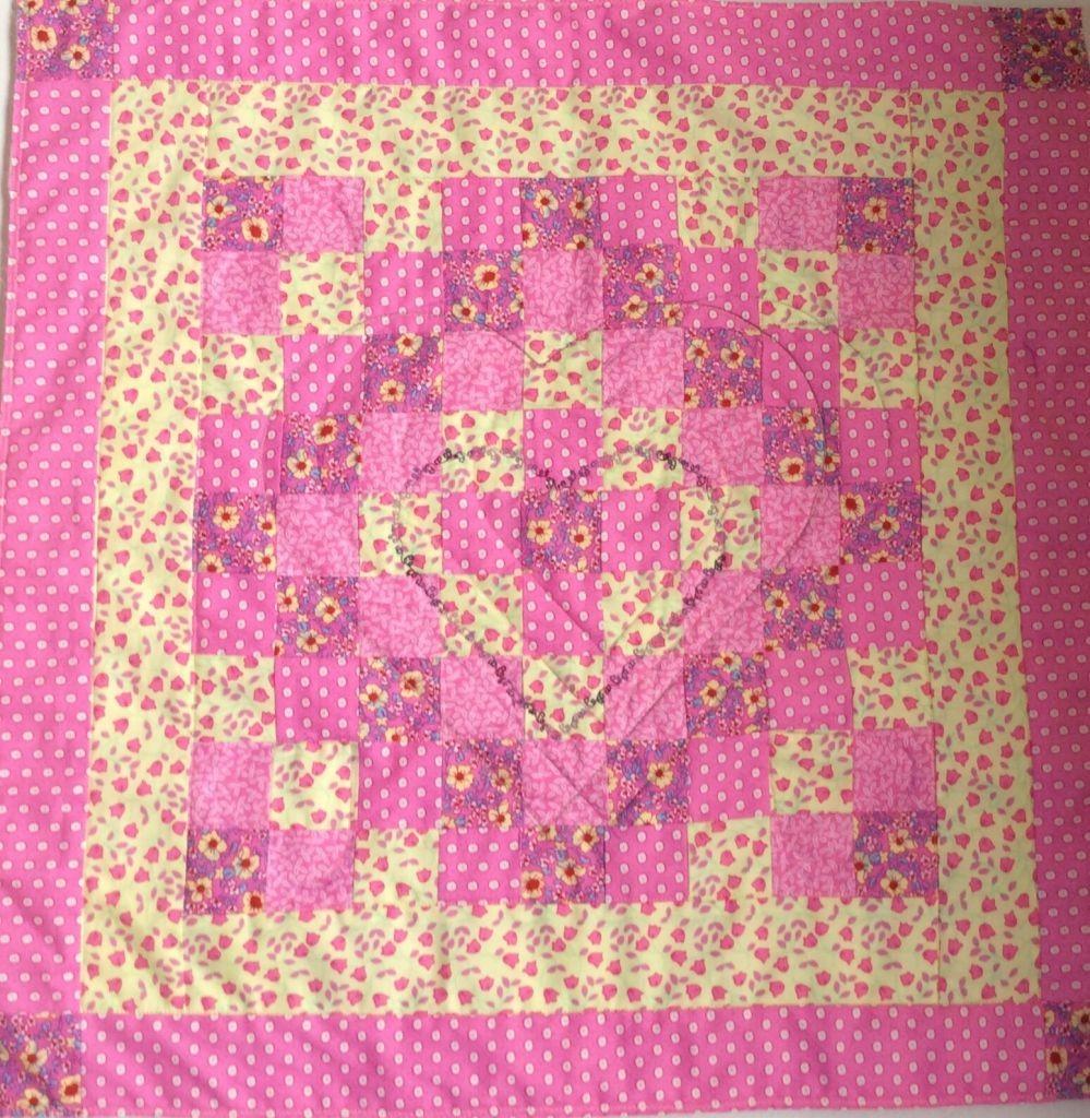 Pink and cream pram quilt