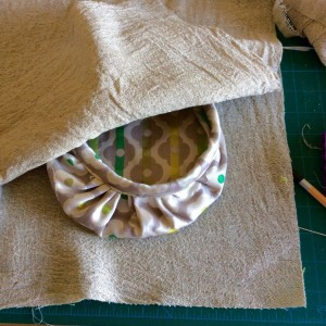 Place the two pieces of hessian right sides together with the cutlery pocket and bowl in the middle