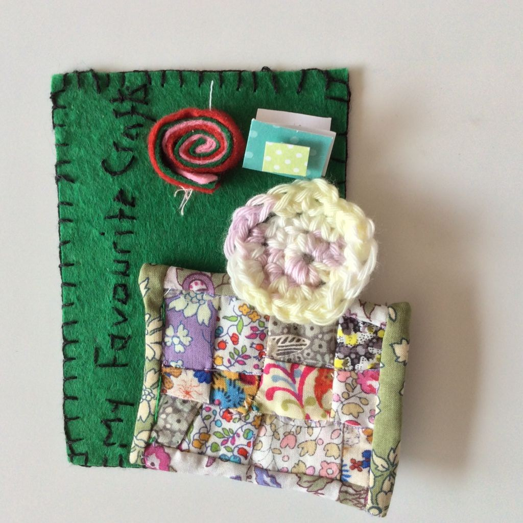 Little card with mini patchwork quilt, some crochet and a little greetings card.