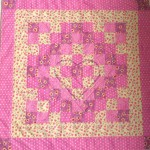 pink and cream patchwork quilt