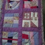purple and pink fabric patchwork quilt