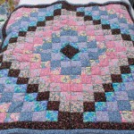 patchwork quilt in blues and pinks