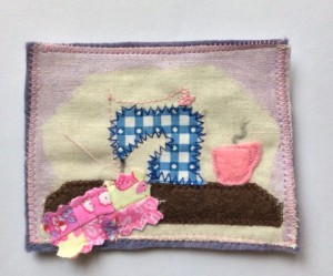 Appliqué sewing machine and quilt with a cup of coffee