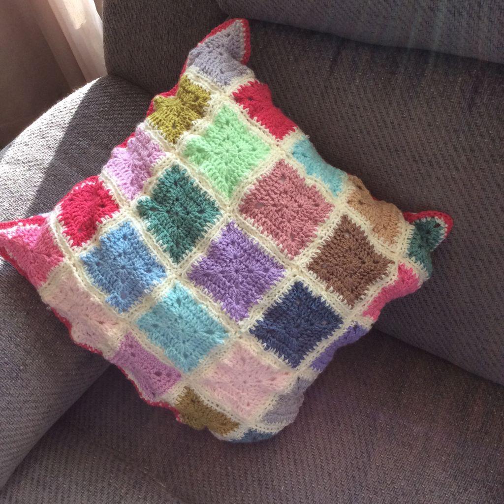 Crochet cushion solid granny squares