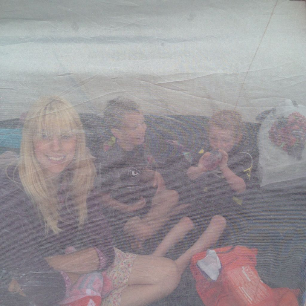 mum and kids in beach tent