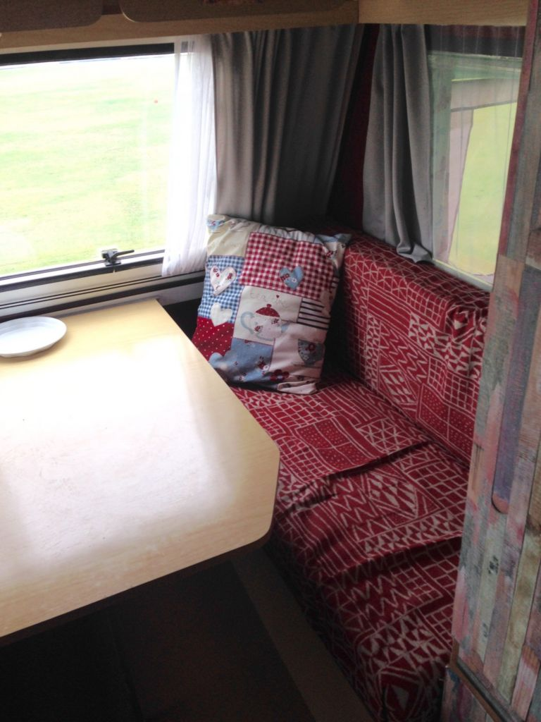 red covered bench seating in caravan
