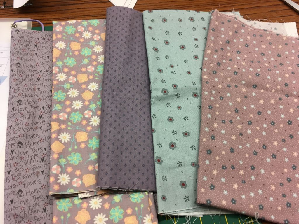 Fabric in shades of green and dusky pink-purple