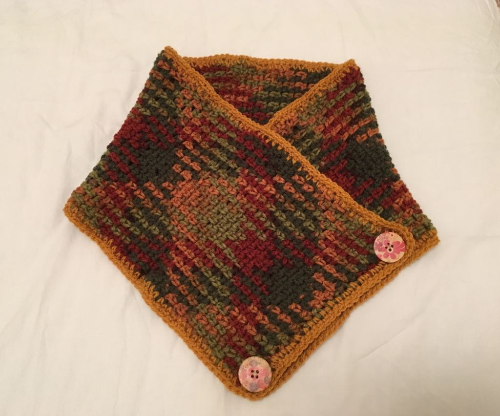 Autumn coloured yarn made into a cowl