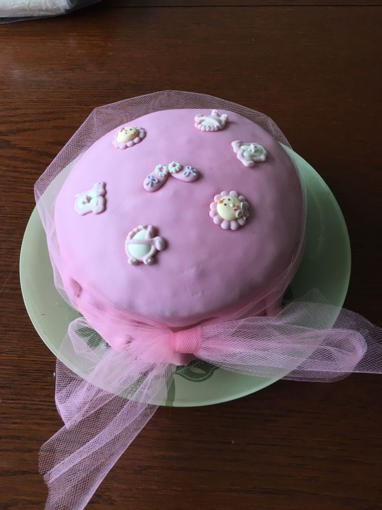 Pink iced baby shower cake