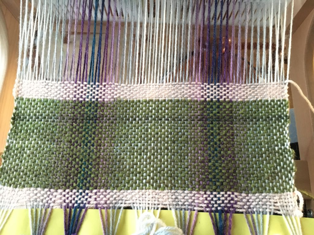 purple and green weaving
