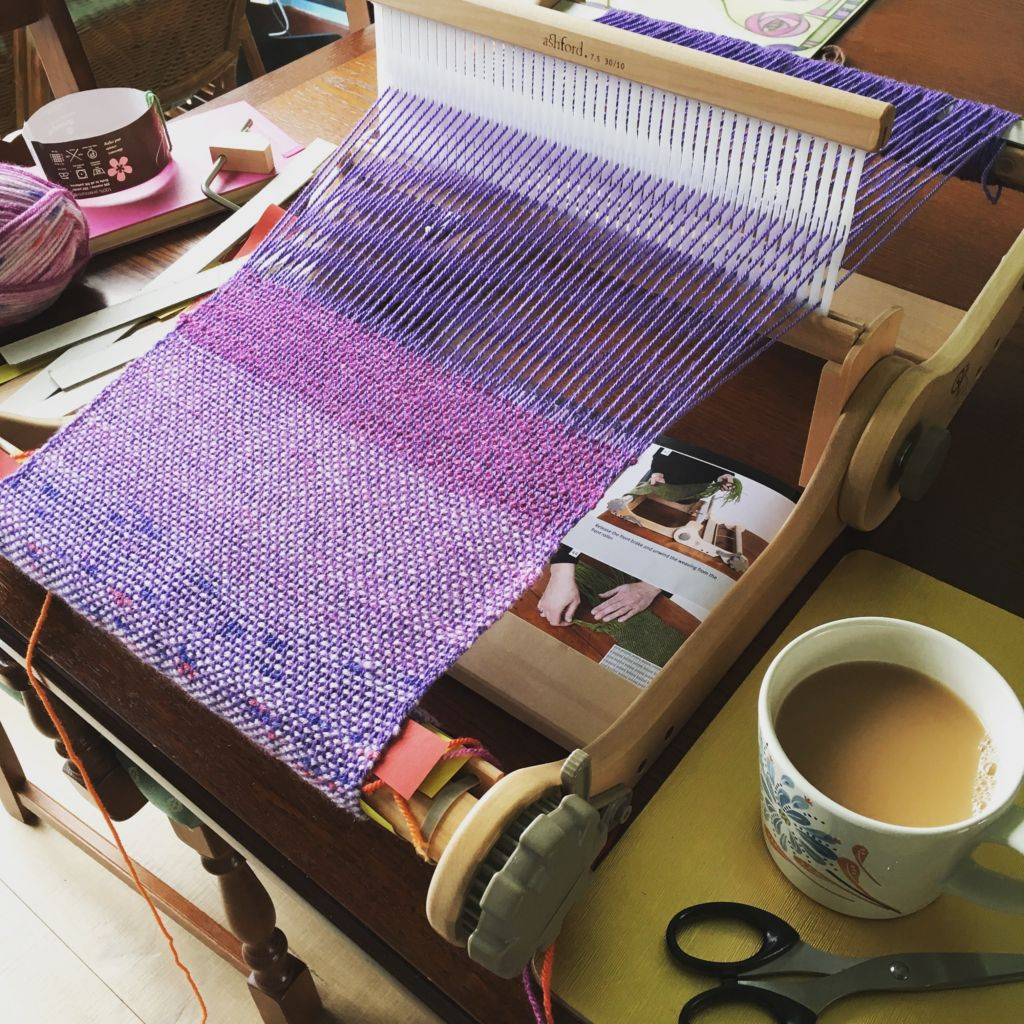purple wool on a loom
