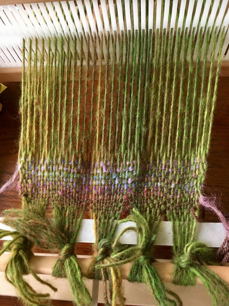 green yarn on a loom