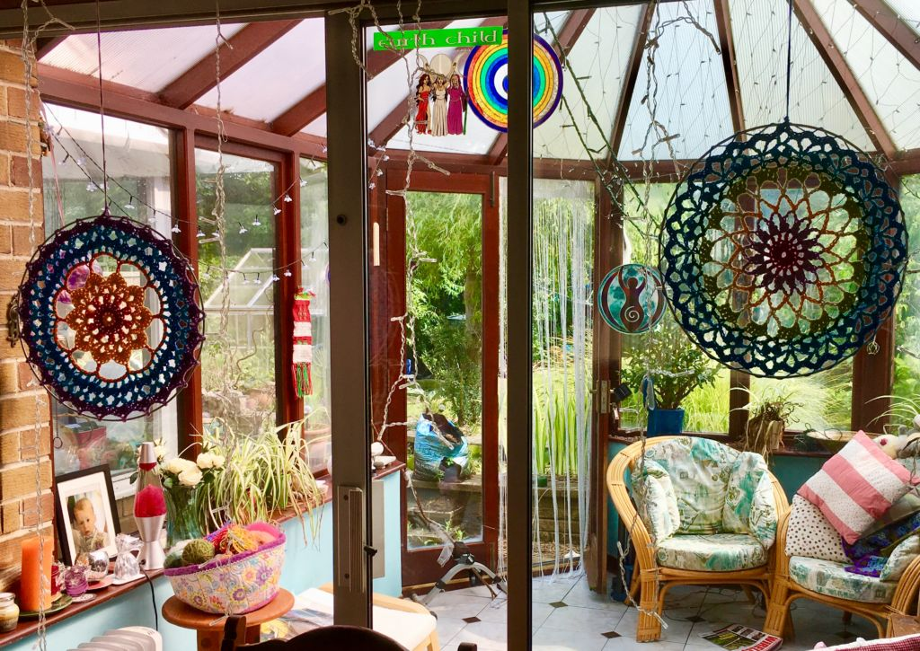 Two Mandalas hanging in a summer room
